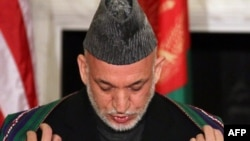 Is Afghan President Hamid Karzai doing enough to fight corruption is his administration?