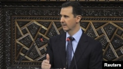 Syrian President Bashar al-Assad delivers a speech to Syria's parliament in Damascus on June 3.
