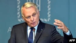 French Foreign Minister Jean-Marc Ayrault discussed Russian President Vladimir Putin's cancelled visit to Paris.