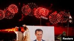Приврзаници на Асад ја слават неговата победа на изборите
