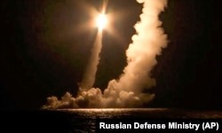 An ICBM is test-launched by a Russian nuclear submarine from the Sera of Okhotsk on December 12.