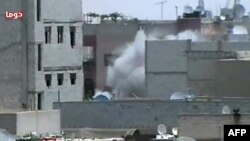 A video grab purportedly shows shelling by government forces of the Damascus suburb of Duma on June 26.