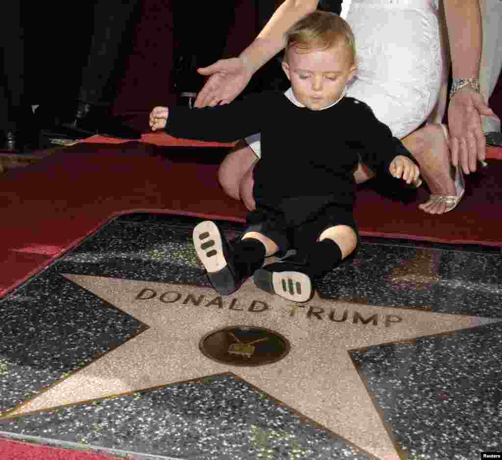 The couple's son Barron plays on his father's star on the Hollywood Walk of Fame in Los Angeles in 2007.