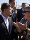 Ukrainian President Volodymyr Zelenskiy (left) listens to a man during a visit to the Zaporizhzhya region on July 18.