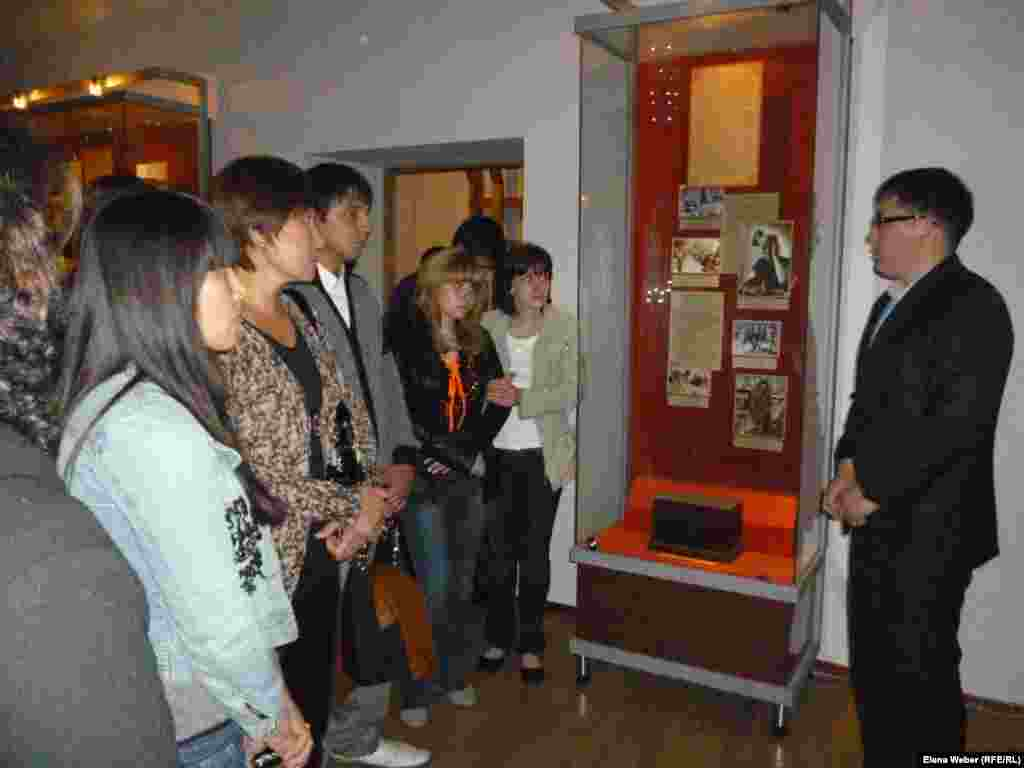 A guide tells visitors how people of different nationalities were deported to Kazakhstan from various parts of the Soviet Union in the years of repression.