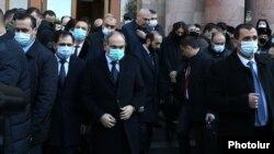 Armenia -- Prime Minister Nikol Pashinian emerges from the main govenment building in Yerevan to lead a procession to the Yerablur Military Pantheon, December 19, 2020.