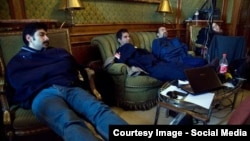 Switzerland--Radio Farda's Hannah Kaviani (far right) and fellow journalists sneak in some much needed sleep at the Iran nuclear talks. Lausanne, April 1, 2015.