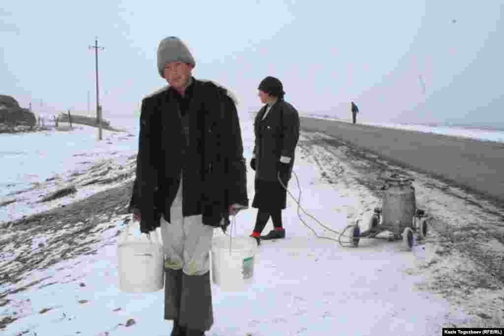 Kazakhs collect water from the Ural River.