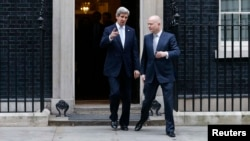 U.S. Secretary of State John Kerry (left) and Britain's Foreign Secretary William Hague leave No. 10 Downing Street in London on February 25.