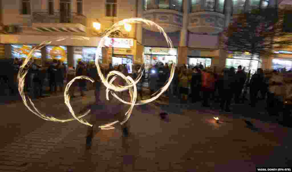 A Bulgarian performer spins fire during the opening ceremony on January 12. Some 1,500 musicians and other artists participated in the opening events.