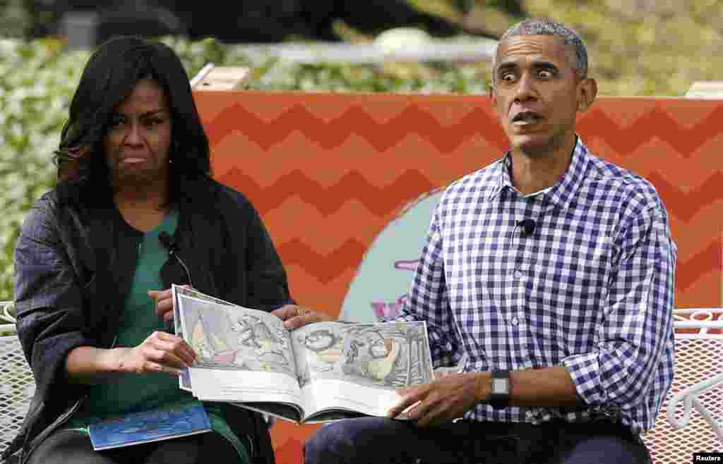U.S. first lady Michelle Obama (left) and President Barack Obama perform a reading of the book Where the Wild Things Are for children gathered for the annual White House Easter Egg Roll on the South Lawn of the White House in Washington on March 28. (Reuters/Jonathan Ernst)