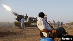 Libya -- NTC fighter test an anti-aircraft gun southwest of Sirte, 16Sep2011