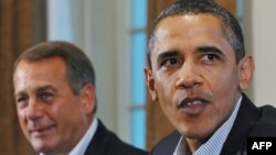 "U.S. President Barack Obama (right) and House Speaker John Boehner need to find a compromise to steer clear of the ""fiscal cliff."""
