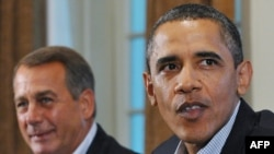 Republican House Speaker John Boehner (left) with President Barack Obama at debt talks in Washington on July 10