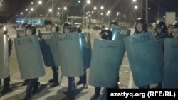 Kazakh riot police cordon off the territory of Prime Plaza after the concert by Kairat Nurtas in Almaty on August 31.