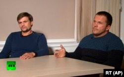 The two suspects -- Ruslan Boshirov (left) and Aleksandr Petrov, both of which may be aliases -- talk to RT.
