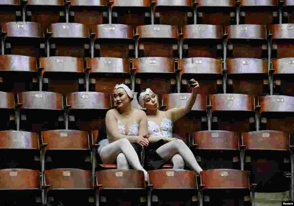 Acrobats relax before the presentation of a new show called The Extreme Arena at the National Circus in Kyiv, Ukraine. (Reuters/Gleb Garanich)