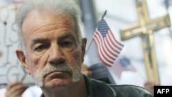 U.S. -- Florida pastor Terry Jones stands at a small protest at the site of the Park 51 proposed mosque and community center in New York, 16Nov2010