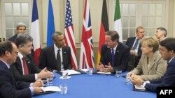 На архівному фото (л > п): Франсуа Олланд, Петро Порошенко, Барак Обама, Дейвід Камерон, Анґела Меркель, Маттео Ренці обговорюють становище в Україні під час саміту НАТО 2014 року