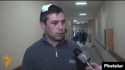 Armenia -- Opposition activist Gevorg Safarian is interviewed by RFE/RL after being assaulted in Yerevan, 28 Nov2014
