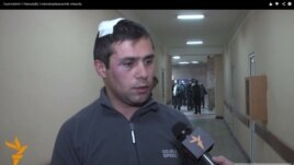 Armenia -- Opposition activist Gevorg Safaryan is interviewed by RFE/RL after being assaulted in Yerevan, 28 Nov2014.