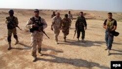 مقاتلون من قوات الحشد الشعبي قرب بيجي