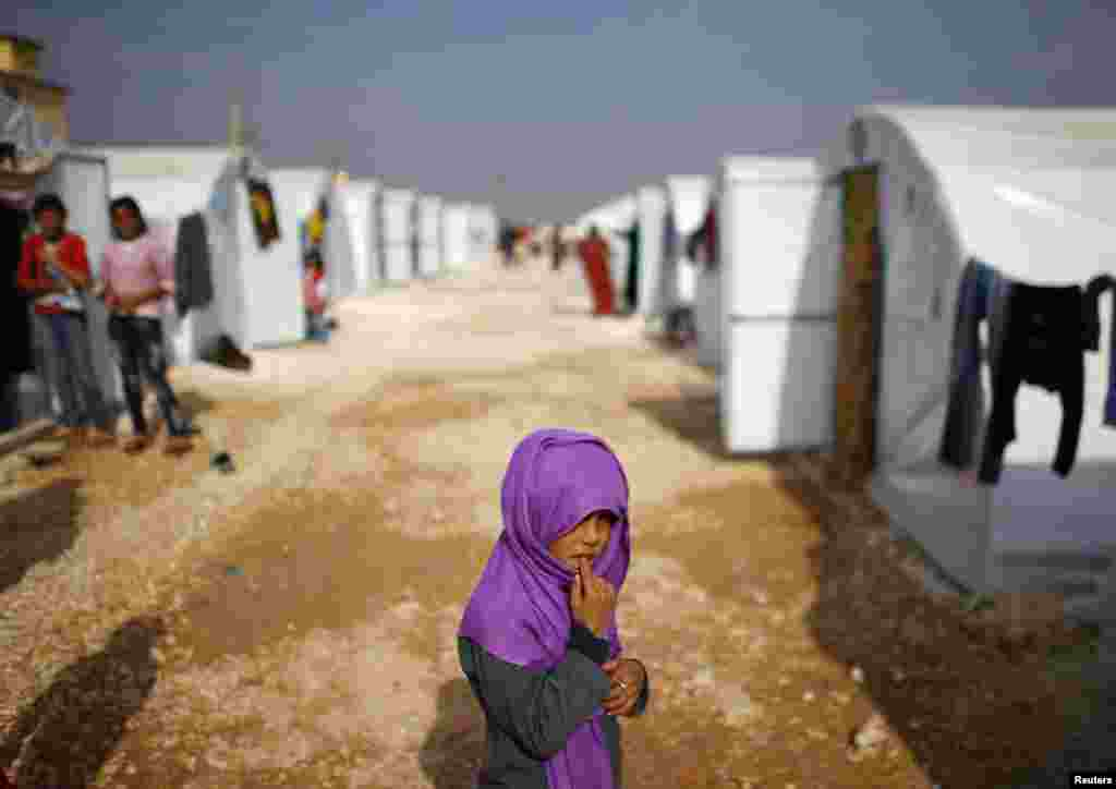 A Kurdish refugee girl from the Syrian town of Kobani is seen in a refugee camp in the Turkish border town of Suruc, in Sanliurfa province. (Reuters/Osman Orsal)