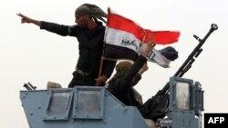 Forcat irakiane e kanë ngritur flamurin kombëtar pas avancimit të sotëm ushtarak kundër militantëve