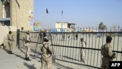 Pakistani paramilitary forces guard a post at the Afghan border.