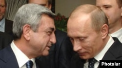 Armenia -- President Serzh Sarkisian (L) talks to Russian Prime Minister Vladimir Putin.