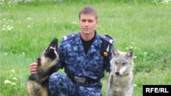 A police officer with the breeding pair.