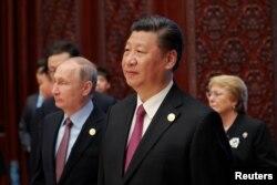 Владимир Путин и Си Цзиньпин на форуме в Пекине. 15 мая
