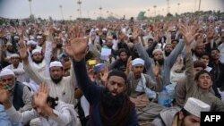 FILE: Supporters of executed Islamist Mumtaz Qadri shout slogans as they sit-in during an anti-government protest front the parliament building in Islamabad in 2016.