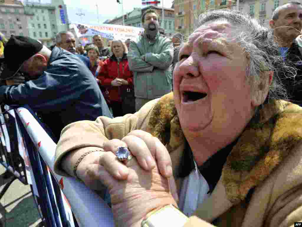 People react after hearing the verdict for Croatian General Ante Gotovina, accused by The Hague's International Criminal Tribunal for former Yugoslavia, in Zagreb's main square on April 15. Gotovina was sentenced to 24 years in prison for war crimes. Photo by Hrvoje Polan for AFP