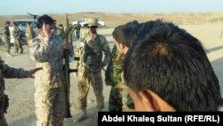 متطوعون اثناء التدريب في معسكر فيشخابور