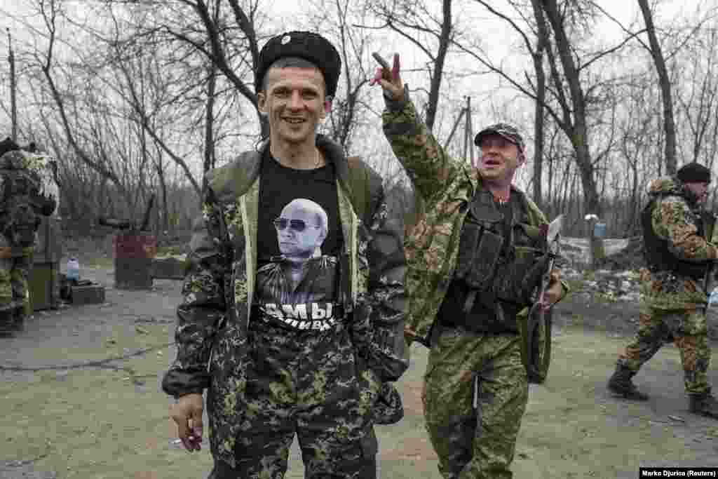 A pro-Russian rebel shows off his T-shirt depicting Russian President Vladimir Putin at a checkpoint in the village of Chornukhyne near the town of Debaltseve, northeast of Donetsk. (Reuters/Marko Djurica)
