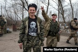 A pro-Russian rebel with a t-shirt depicting Russian President Vladimir Putin at a checkpoint in eastern Ukraine.