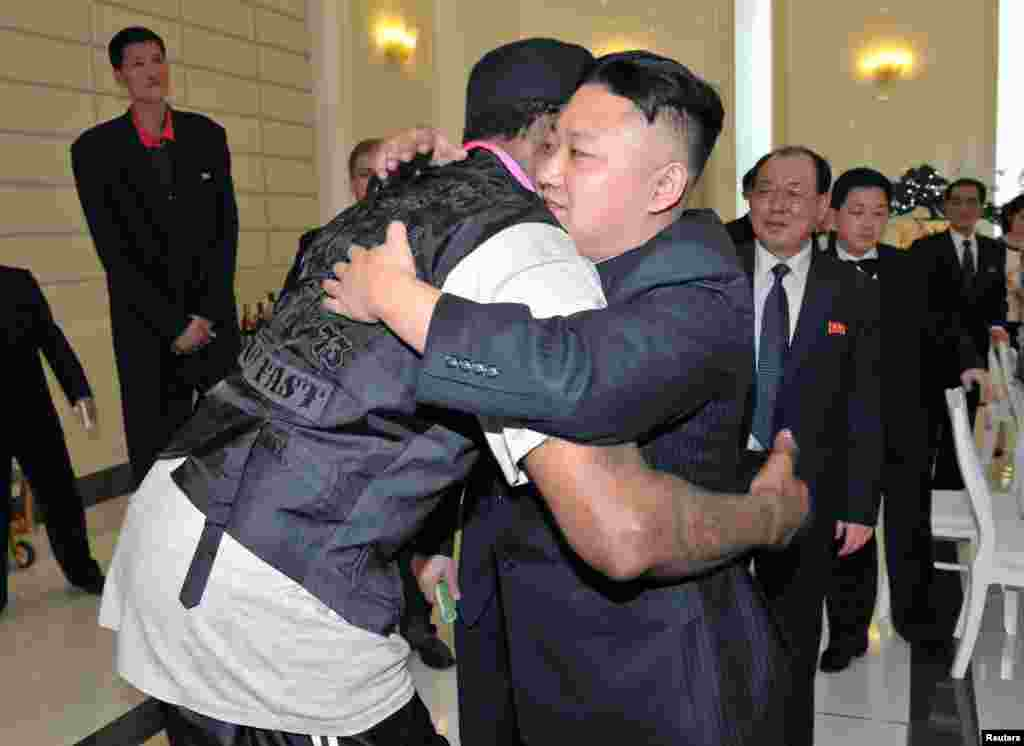North Korea leader Kim Jong Un and Dennis Rodman hug in Pyongyang during a visit by the former NBA basketball star. (Reuters/KCNA)
