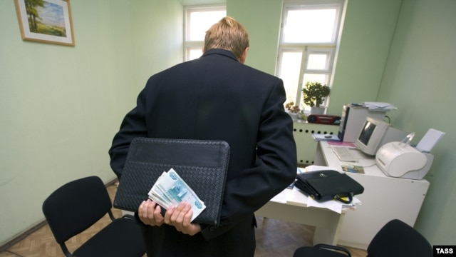 A visitor at a state administrative office holding money to bribe a clerk in Kurgan in September 2007