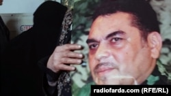 A mourner holds a photo of Samir Kantar, a senior Hizballah militant, at his funeral in Beirut on December 21.