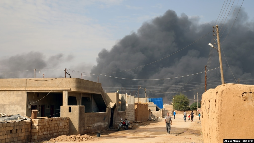 Smoke clouds rise from the scene of clashes between the Syria democratic forces (SDF) and Turkish troops and their Syrian opposition allies near Ras al-Ain town, October 17, 2019