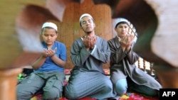 Kyrgyz boys during Friday Prayers in Bishkek (file photo)