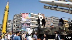 An Iranian Shahab-3 missile (left) is displayed during a rally in Tehran in June 2017.