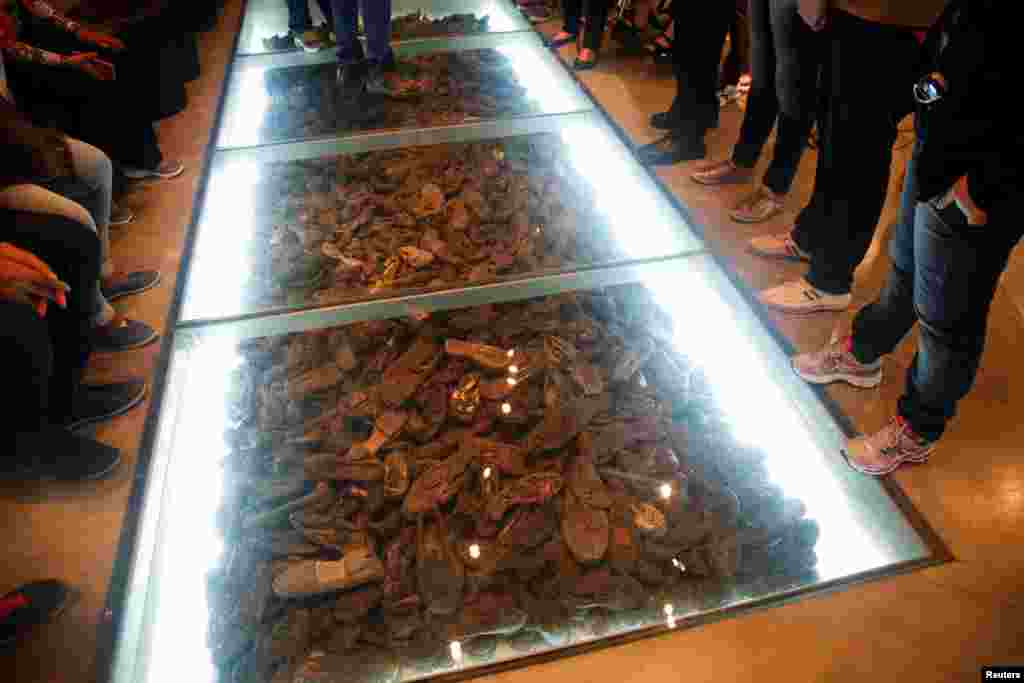 Visitors view an exhibit comprising shoes belonging to Holocaust victims during a visit to Yad Vashem's Holocaust History Museum in Jerusalem. Starting on the evening of May 4, Israel marks its annual Holocaust Remembrance Day commemorating the 6 million Jews killed by the Nazis during World War II. (Reuters/Ronen Zvulun)