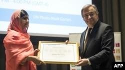 Malala Yousafzai is presented with a certificate by UN Secretary-General Antonio Guterres during a ceremony to name her as a messenger of peace at UN headquarters in New York on April 10.