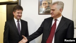 President-elect Tomislav Nikolic (right) greets Slovak Foreign Minister Miroslav Lajcak in Belgrade on May 24.