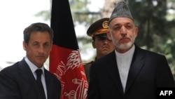 French President Nicolas Sarkozy (left) with Afghan President Hamid Karzai in Kabul on July 12.