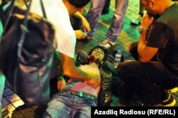 An injured protester is attended to after riot police used tear gas and water cannons to suppress a rally against the demolition of Istanbul's Gezi Park in July 2013.