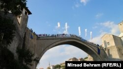 Spectators watch as competitors take the dive off Mostar's Old Bridge on July 29.