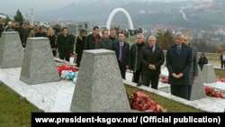 Kosovar President Hashim Thaci (right) visits a memorial in the village of Recak on International Human Rights Day.